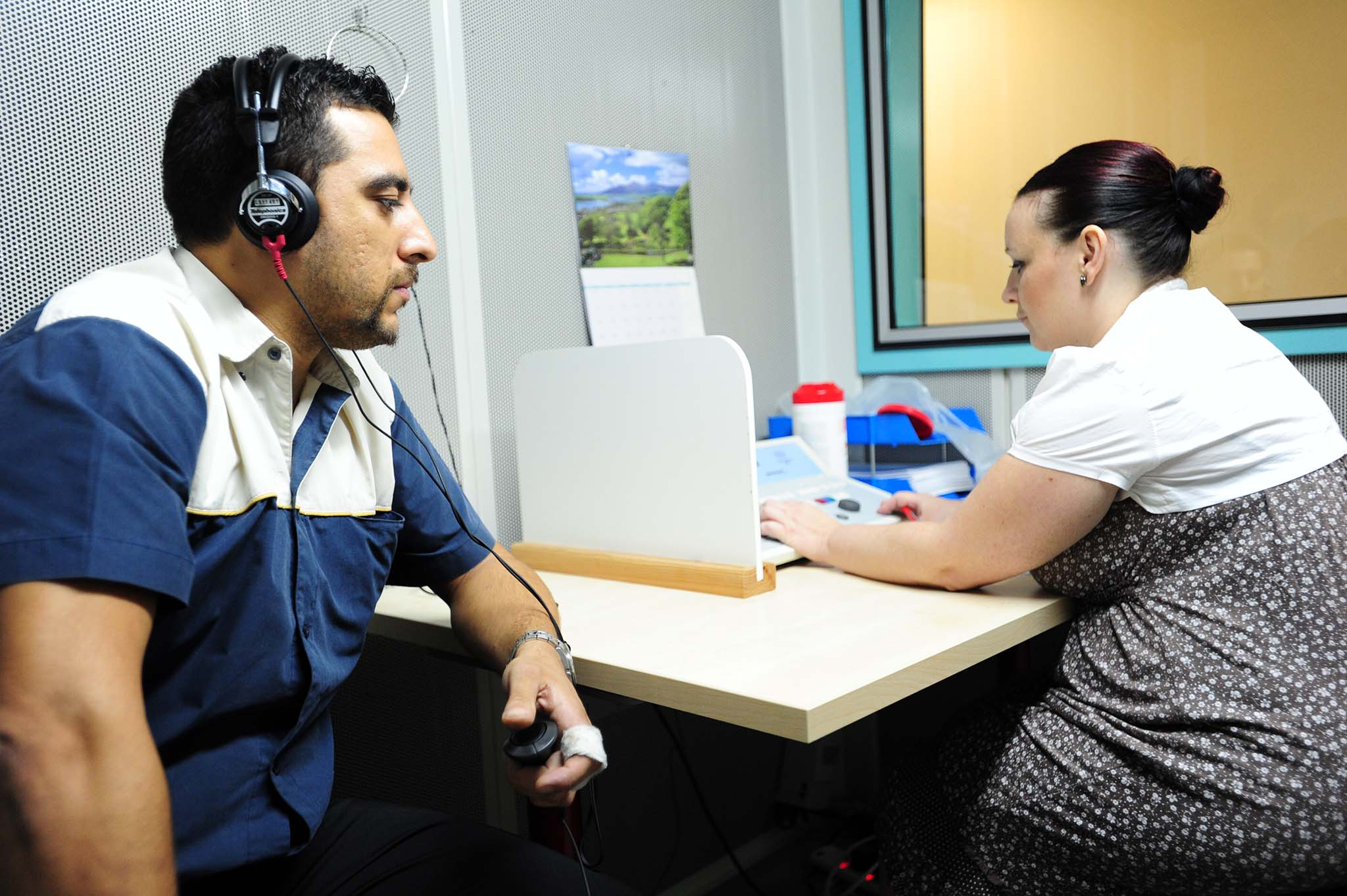 Audiology test being performed on a patient