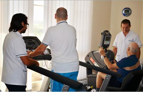 Physiotherapy staff assisting patients with physical activities and training