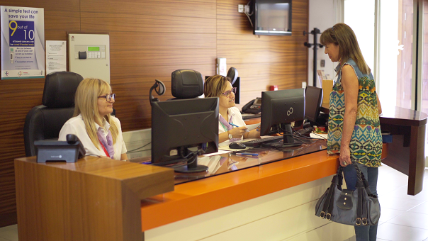 Receptionists greeting a patient